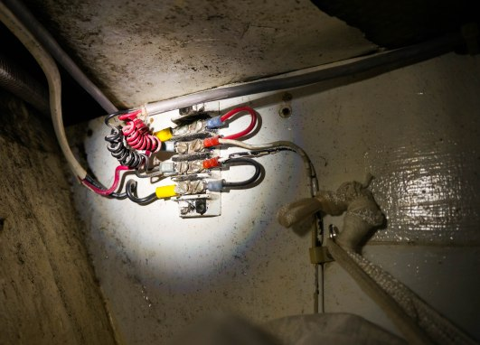 The lights we use when cruising at night have wiring that comes in through the hull and Craig had to disconnect and reconnect it.